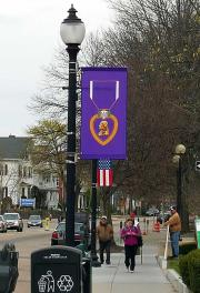 Custom purple heart lightpole banner