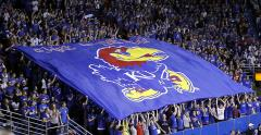KU giant fan flag in crowd at football game
