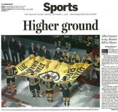 Newspaper article showing our custom championship banner for the Boston Bruins