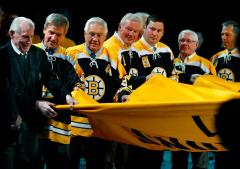 Custom Bruins 2011 championship banner carried by team veterans