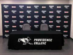 Custom media backdrop and hand-sewn table drape for Providence College