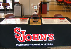 Custom recruiting table drape for St. John\'s