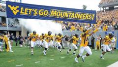 West Virginia custom football run under banner